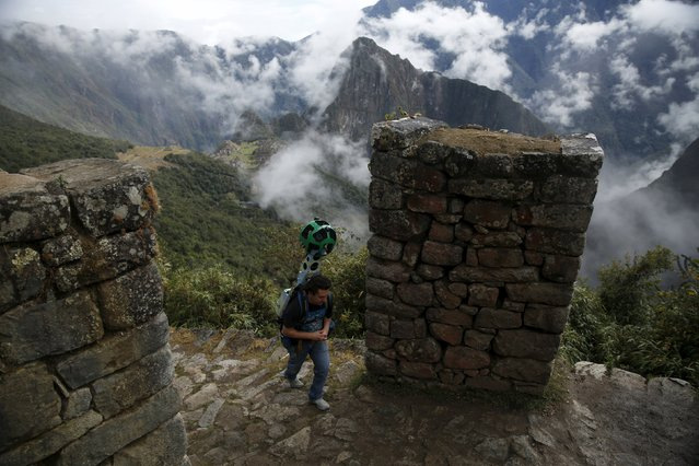 An operator walks carrying the Trekker, a 15-camera device, while mapping the Inca citadel of Machu Picchu for Google Street View in Cuzco, Peru, August 12, 2015. (Photo by Pilar Olivares/Reuters)