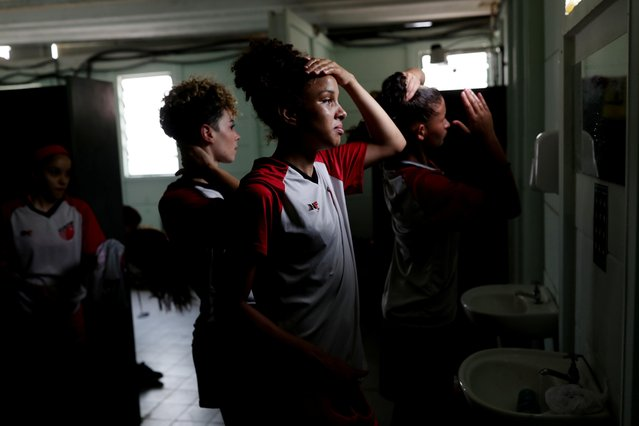 """Taboao da Serra's Geovana Mendes and teammates look dejected in the dressing room after their 16-0 loss against Palmeiras in Vinhedo, Brazil, November 11, 2020. When the team lost a league match 29-0 last month it looked like things could hardly get much worse for the small club based outside Sao Paulo. They also lost their next three games 14-0, 10-0 and 16-0 and were eliminated from the Sao Paulo state championship at the group stage. The results sparked yet another debate about the competitiveness of the women's game in Brazil. The backlash – and of course the sexist ridicule – was even more predictable. When we lost """"they said it looks like the whole team has COVID-19, don't bother playing, those kind of things, you know"""", said captain Lohane Ferreira. (Photo by Amanda Perobelli/Reuters)"""