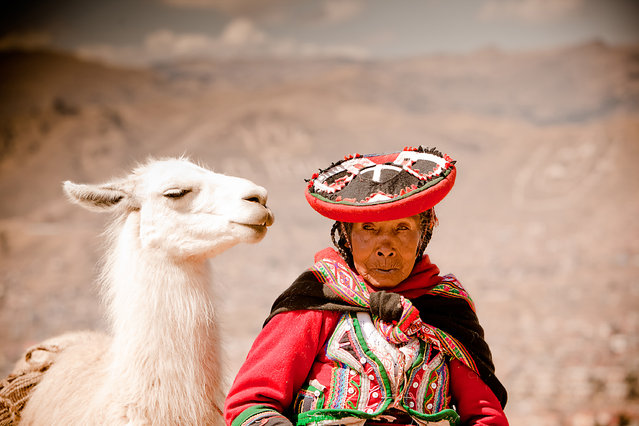"""A Peruvian Woman and her Lama"". I LOVE when people look like their pets. This Peruvian Woman was trying to make money by posing for tourists with her pet Llama at Sacsayhuamán, Ruins, Cusco, Peru. (Photo and caption by Laura Grier/National Geographic Traveler Photo Contest)"
