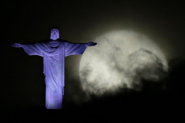 The moon is pictured next to Christ the Redeemer statue ahead the visit of Pope Francis in Rio de Janeiro, on July 21, 2013. (Photo by Ricardo Moraes/Reuters)