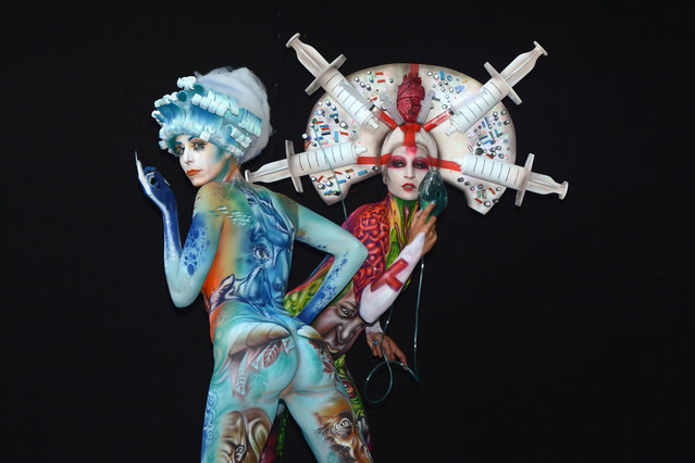 Models, painted by bodypainting artist Alex Hansen from Brasil and Benoit Botella from Guadaloupe, pose for a picture at the 21st World Bodypainting Festival 2018 on July 14, 2018 in Klagenfurt, Austria. (Photo by Didier Messens/Getty Images)