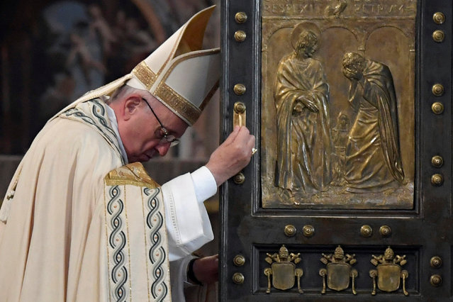 Pope Francis closes the Holy Door to mark the closing of the Catholic Jubilee Year of Mercy in the Saint Peter's Basilica at the Vatican November 20, 2016. (Photo by Tiziana Fabi/Reuters)
