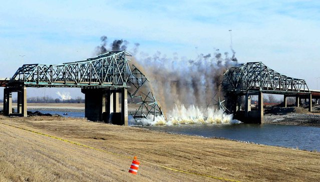 The westbound span of the obsolete Chain of Rocks Canal Bridge, in St. Louis, Mo., is demolished, Tuesday, February 3, 2015, resulting in the closure of Interstate 270 in both directions between Riverview Boulevard in St. Louis and Illinois Route 3. The eastbound span was destroyed on Jan. 20. (Photo by Christian Gooden/AP Photo/St. Louis Post-Dispatch)