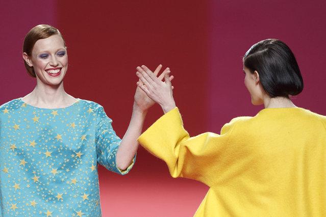 Models clap their hands while displaying Autumn/Winter designs by Agatha Ruiz De La Prada at Madrid's Fashion Week in Madrid, Spain, Tuesday, February 10, 2015. (Photo by Daniel Ochoa de Olza/AP Photo)