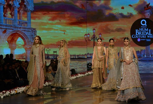 Models present creations by Pakistani fashion designer Uzma Babar on the final day of the Fashion Bridal Couture Week in Lahore on November 27, 2016. (Photo by Arif Ali/AFP Photo)