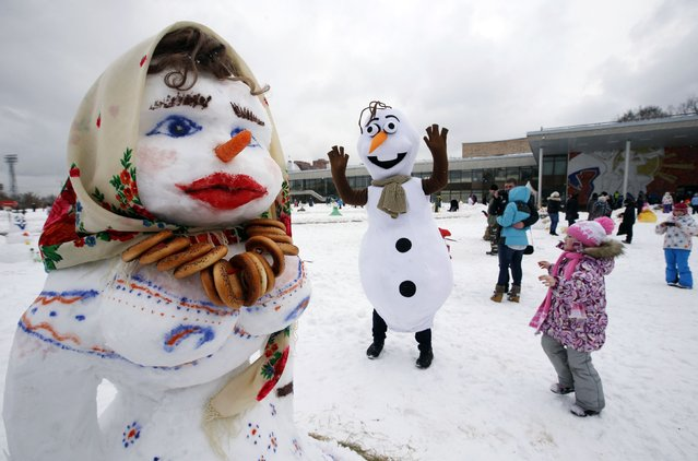 People attend an amateur snowman parade and contest in Moscow February 7, 2015. (Photo by Sergei Karpukhin/Reuters)