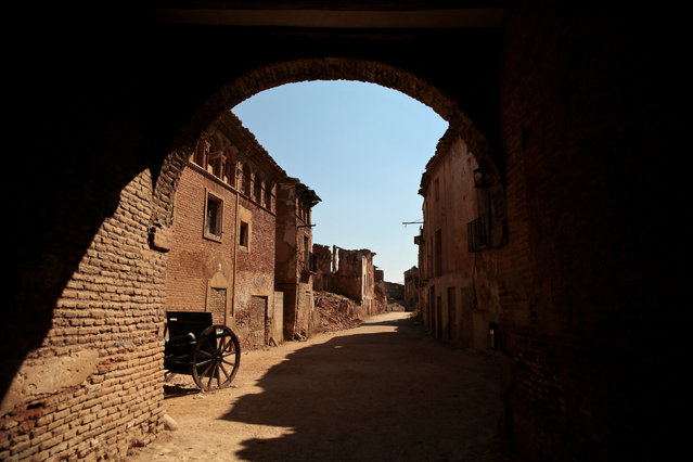 The entrance to the ruins of the old village of Belchite is seen in northern Spain, October 3, 2016. Almost 80 years ago Tomas Ortin fled under the cover of night from his home in the small town of Belchite on Spain's northern plains to escape with hundreds of others from one of the bloodiest battles of the country's civil war. At 94 years old, Ortin now lives just across the road from Belchite, which has lain in ruins since Republican forces attacked it, a symbol of the destruction caused by the 1936-1939 war in which an estimated 500,000 people died. The siege of Belchite was part of a Republican offensive in 1937 to capture Zaragoza, capital of the Aragon region, from the Nationalists led by General Francisco Franco, who went on to win the war and establish a dictatorship that lasted 40 years. Nationalist-controlled Belchite represented a key obstacle given its strategic location in the red-brown hills south of Zaragoza. As many as 6,000 people died defending it before those left surrendered. It became one of the civil war's most infamous battles. (Photo by Andrea Comas/Reuters)