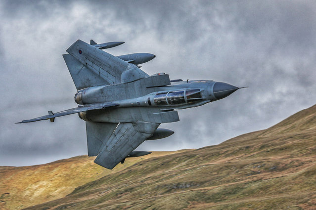 """Magnificent Tonka"". Amateur photographer, second prize: Taken on the Mach Loop from Cad West, a Tornado GR4 manoeuvres through the valleys. (Photo bu Stacy Woolhouse/RAF)"