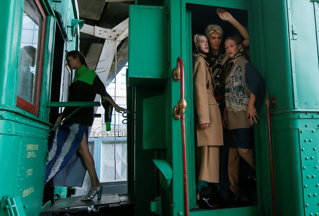 Models wait for a presentation of the creations by Ukrainian designer Jean Gritsfeldt during Ukrainian Fashion Week at the railway station in Kiev, Ukraine on September 2, 2018. (Photo by Valentyn Ogirenko/Reuters)