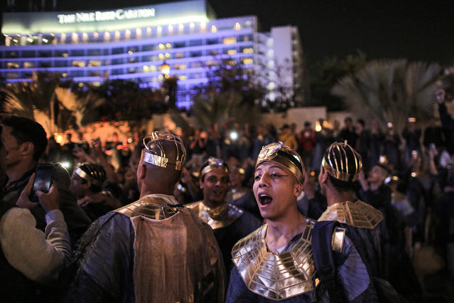 Performers dressed in ancient Egyptian costume mingle after the end of the parade of 22 ancient Egyptian royal mummies departing from the Egyptian Museum in Cairo's Tahrir Square on April 3, 2021, headed to their new resting place at the new National Museum of Egyptian Civilisation (NMEC) about seven kilometres south in historic Fustat (Old Cairo). (Photo by Mahmoud Khaled/AFP Photo)