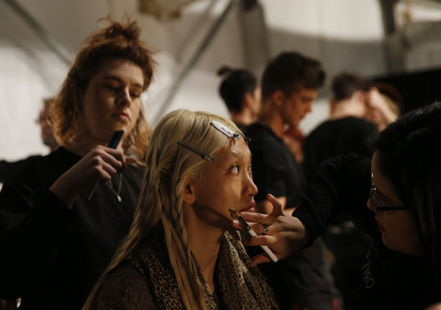 A model is made-up backstage before the iiJin  Fall/Winter 2015 collection show at New York Fashion Week, February 18, 2015. (Photo by Shannon Stapleton/Reuters)
