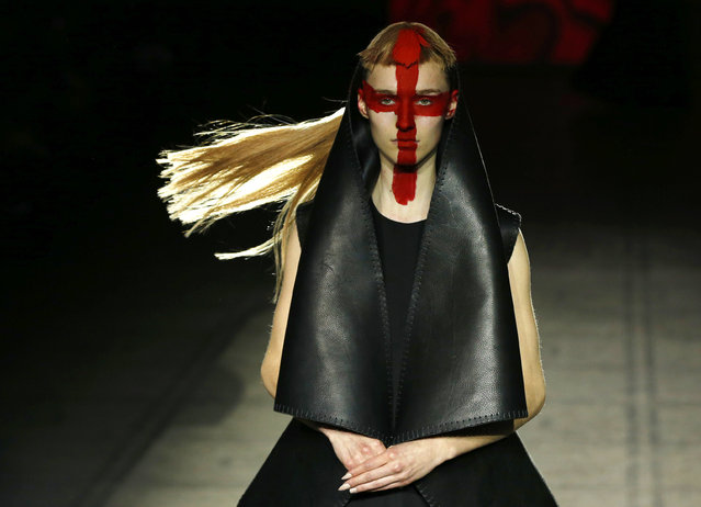 In this Saturday February 21, 2015 file photo, a model wears an outfit by designer Gareth Pugh during his Autumn/Winter 2015 show at London Fashion Week, in London. (Photo by Alastair Grant/AP Photo)