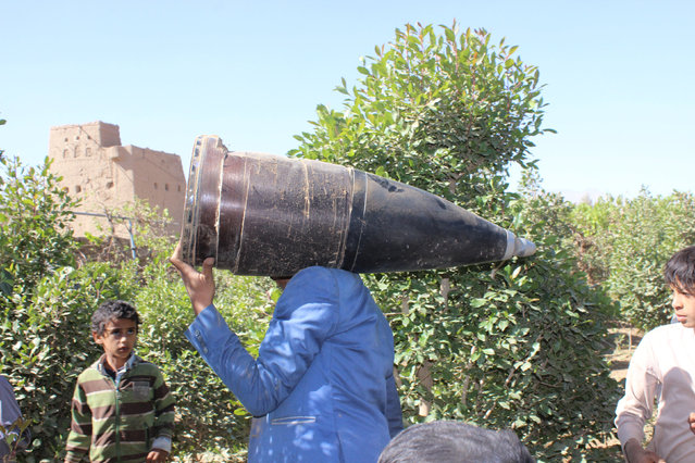 A man carries a part of a missile he says was dropped during a Saudi-led air strike near the northwestern city of Saada, Yemen December 7, 2016. (Photo by Naif Rahma/Reuters)