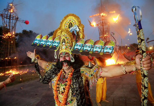 An artist dressed as demon King Ravana reacts as he participates in Vijaya Dashmi, or Dussehra festival celebrations in Chandigarh, India October 19, 2018. (Photo by Ajay Verma/Reuters)