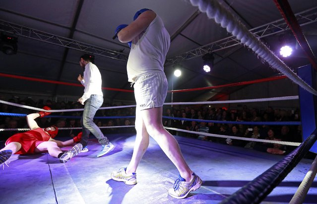 Fr Pierre Pepper (C) reacts after knocking down Jared Madden during his amateur boxing match in the town of Banagher  in County Offaly March 15, 2015. (Photo by Cathal McNaughton/Reuters)