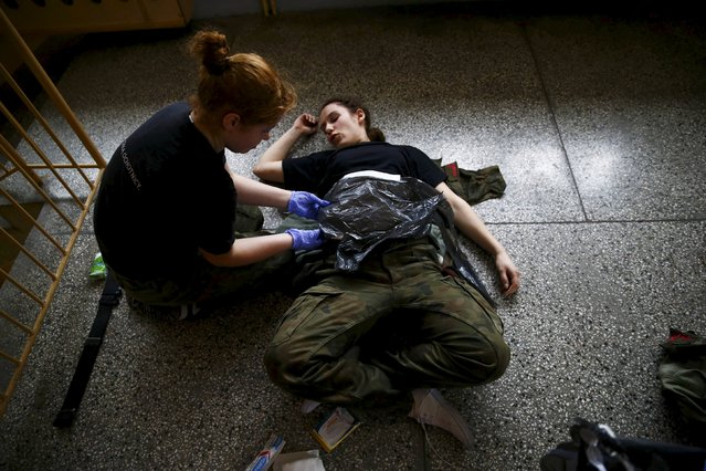 Urszula Sidoruk (R), 19, takes part in a medical course organised by paramilitary organisation called Obrona Narodowa (National Defence) in Mrozy near Minsk Mazowiecki, eastern Poland February 28, 2014. (Photo by Kacper Pempel/Reuters)