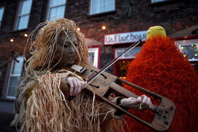 Costumed participants are seen during an Irish tradition of Hunting of the Wren festival held every St. Stephen's Day in Dingle, Ireland, December 26, 2016. (Photo by Clodagh Kilcoyne/Reuters)