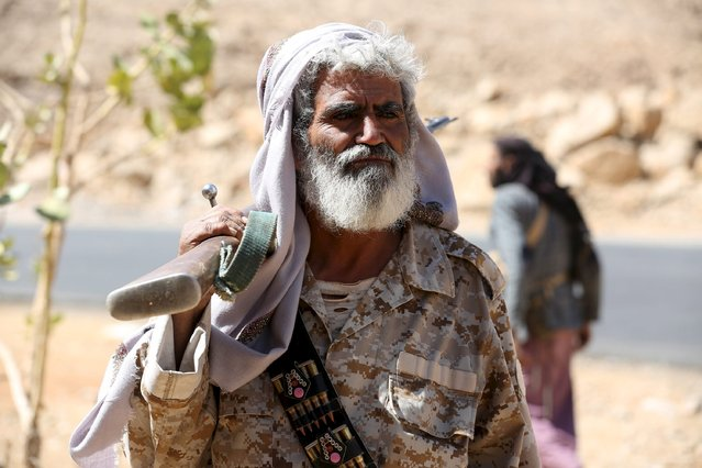 A tribal militant loyal to Yemen's government holds his weapon as he secures a road taken over by the pro-government army and tribal fighters from Houthi militants in Furdhat Nihem area near the capital Sanaa February 3, 2016. (Photo by Ali Owidha/Reuters)