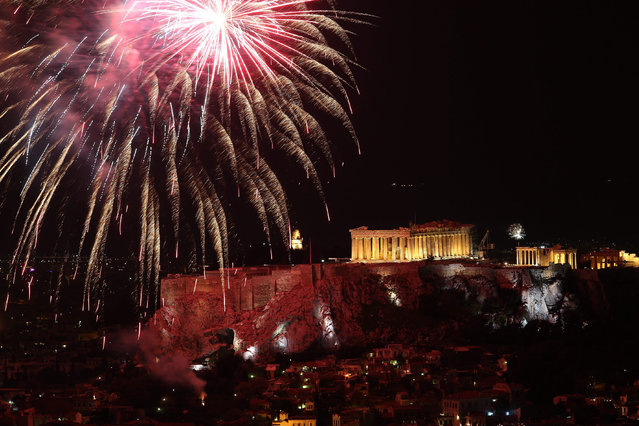 Fireworks illuminate the sky over the ancient Parthenon temple on the Acropolis Hill in Athens, Greece, for the celebrations of the New Year, 01 January 2017. (Photo by Simela Pantzartzi/EPA)