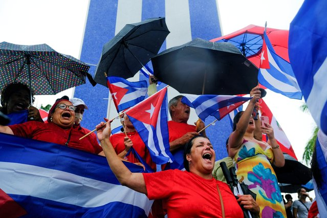 Emigres in the Little Havana neighborhood react as they gather following reports of protests in Cuba against its deteriorating economy, in Miami, Florida, U.S. July 13, 2021. (Photo by Maria Alejandra Cardona/Reuters)