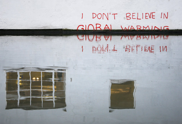 Graffiti art is seen on a wall next to the Regent's Canal, in Camden in London December 22, 2009. (Photo by Luke MacGregor/Reuters)