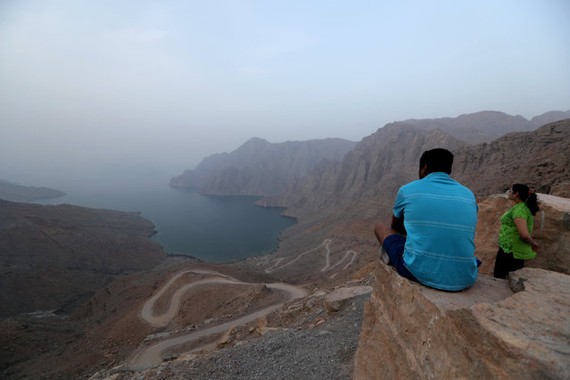 Tourists enjoy the view from Khor Najd Mountain in Musandam province, Oman, July 20, 2018. Picture taken on July 20, 2018. (Photo by Hamad I Mohammed/Reuters)
