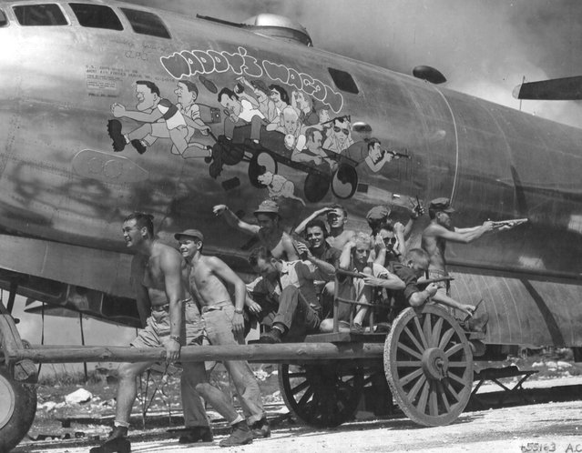 "The crew of the B-29 ""Waddy's Wagon"" posing to duplicate their caricatures in the nose art. This was the fifth B-29 to take off from Saipan on the first raid on Tokyo. She was lost on January 9, 1945 mission to Tokyo. They ditched in the Pacific Ocean near the island of Hachijo Shima. (Photo from D. Sheley collection)"