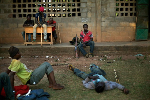 Former FARCA (Central African Republic Forces) soldiers linked to Anti-Balaka Christian militiamen in a camp set up in a school in the Boeing neighborhood of the Central African Republic's capital Bangui Sunday December 15, 2013. (Photo by Jerome Delay/AP Photo)
