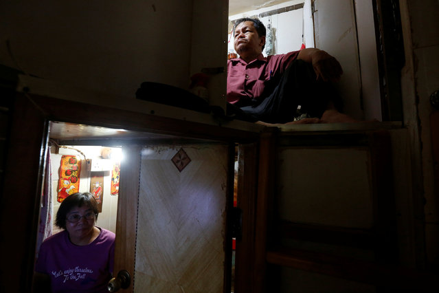 """Unemployed Hong Kong residents Lam (R), 60, and Kitty Au, 63, rest inside their upper and lower decks partitioned units, or """"coffin units"""", in Hong Kong, China October 31, 2016. (Photo by Bobby Yip/Reuters)"""