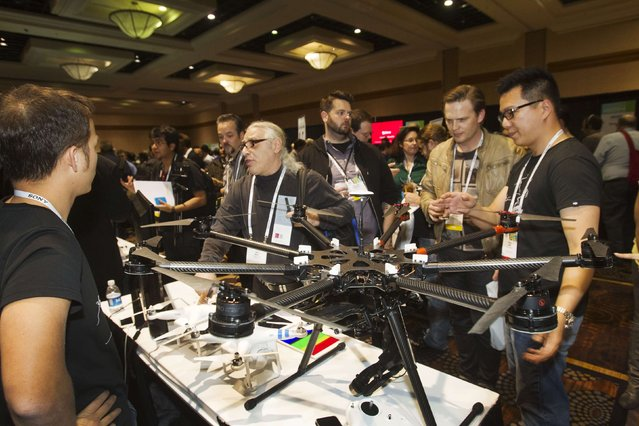 "The DJI S1000, an eight-bladed, aerial photography system by DJI Innovations, is displayed during ""CES Unveiled"", a media preview event to the annual Consumer Electronics Show (CES), in Las Vegas, Nevada, January 5, 2014. (Photo by Steve Marcus/Reuters)"