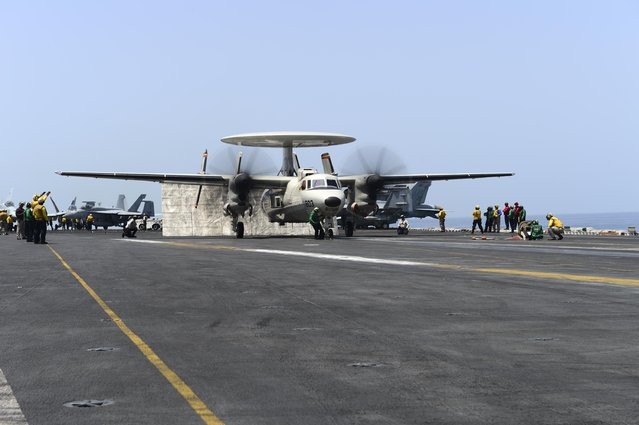 An E-2D Hawkeye launches from the flight deck of the aircraft carrier USS Theodore Roosevelt (CVN 71) during maritime security operations in the Arabian Sea in this U.S. Navy photo taken April 21, 2015. (Photo by Mass Communication Specialist 3rd Class Josh Petrosino/Reuters/U.S. Navy)