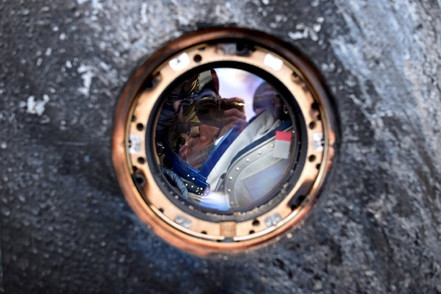 Russian cosmonaut Mikhail Korniyenko is seen inside a Soyuz capsule shortly after landing near the town of Dzhezkazgan (Zhezkazgan), Kazakhstan, March 2, 2016. (Photo by Kirill Kudryavtsev/Reuters)