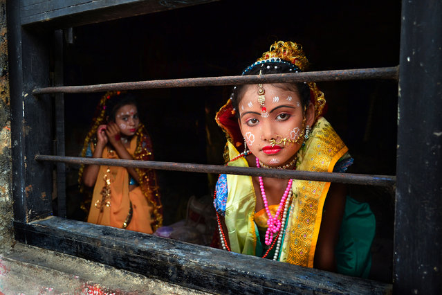 """Festive preparation"". Baghnapara, Bardhaman, West Bengal, India. Two girls prepare for the Gajan festival. They will perform a play based on Indian mythology. (Photo by Krishnasis Ghosh)"