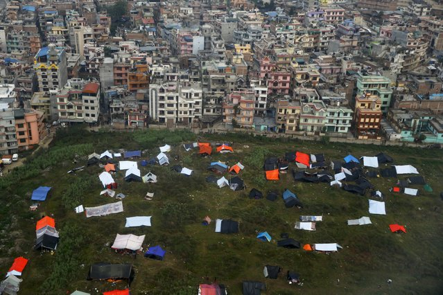 Nepali sleep in provisional tents and under plastic sheets after Saturday's earthquake, near the airport of Kathmandu, Nepal April 28, 2015. (Photo by Wolfgang Rattay/Reuters)