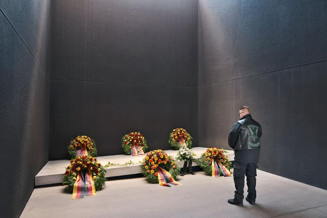 A veteran of Germany's military deployment in Afghanistan pauses at the wreath of a fellow soldier killed in Afghanistan in 2010 at a memorial that commemorates members of the Bundeswehr, Germany's armed forces, killed in the line of duty following a ceremony to honor Germany's 20-year Afghanistan military mission on October 13, 2021 in Berlin, Germany. Germany withdrew its forces from Afghanistan earlier this year as part of the general withdrawal of NATO forces. A total of 59 members of the Bundeswehr lost their lives during Germany's 20-year military presence in Afghanistan. (Photo by Sean Gallup/Getty Images)