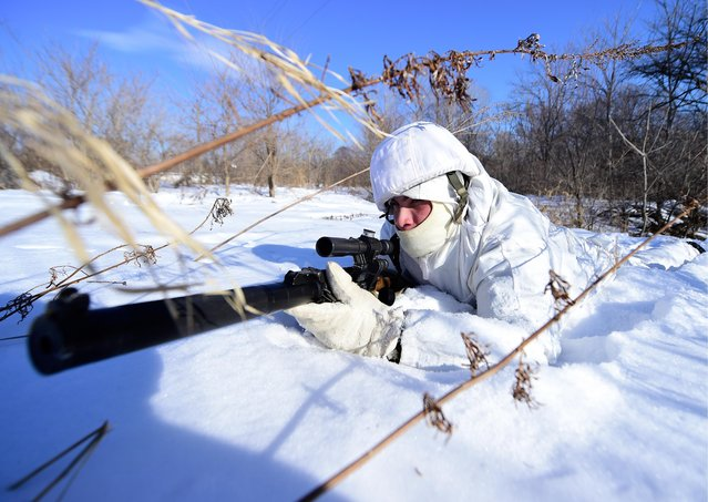 A serviceman during military exercises conducted by the Russian Pacific Fleet' s naval infantry unit at the Bamburovo firing range on February 2, 2017. (Photo by Yuri Smityuk/TASS)