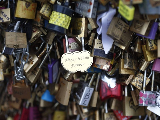 "Names ""Alexey & Inna"" are seen on one of the many padlocks on the Pont des Arts over the River Seine. (Photo by Charles Platiau/Reuters)"
