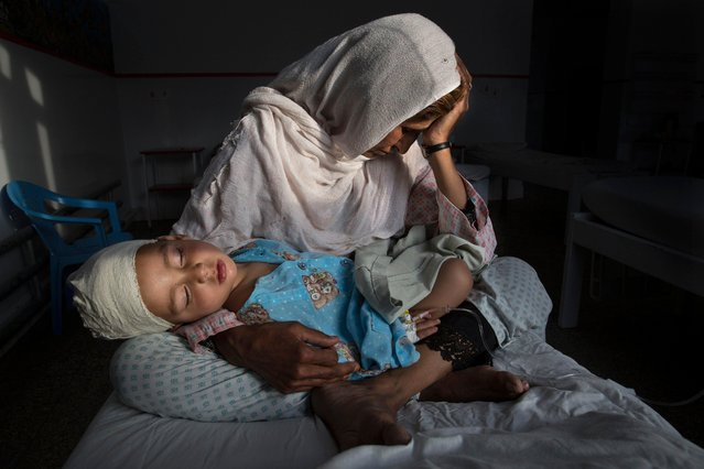 A handout image provided by the World Press Photo (WPP) organization on 13 February 2017 shows a picture by Time Lightbox photographer Paula Bronstein that won the Daily Life – First Prize, Singles award of the 60th annual World Press Photo Contest, it was announced by the WPP Foundation in Amsterdam, The Netherlands on 13 February 2017. Caption: At the hospital, Najiba holds her two-year-old nephew Shabir who was injured from a bomb blast in Kabul on 29 March 2016. Afghanistan has endured armed conflict since 1979, when the Soviet Union invaded. Afghan civilians are at greater risk today than at any time since Taliban rule, which ended in 2001. According to UN statistics, in the first half of 2016 at least 1,600 people died, and more than 3,500 people were injured. Despite billions of dollars spent by the international community to stabilize the country, Afghanistan has seen little improvement in terms of overall stability and human security. (Photo by Paula Bronstein/EPA/World Press Photo)