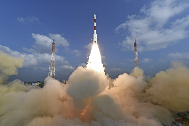 This photograph released by Indian Space Research Organization shows its polar satellite launch vehicle lifting off from a launch pad at the Satish Dhawan Space Centre in Sriharikota, India, Wednesday, February 15, 2017. India's space agency said it successfully launched more than 100 foreign nano satellites into orbit Wednesday aboard a single rocket.(Photo by Indian Space Research Organization via AP Photo)