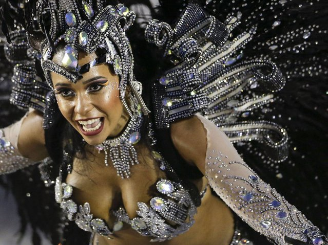 A performer from the Beija Flor samba school parades during carnival celebrations at the Sambadrome in Rio de Janeiro. (Photo by Felipe Dana/AP Photo)
