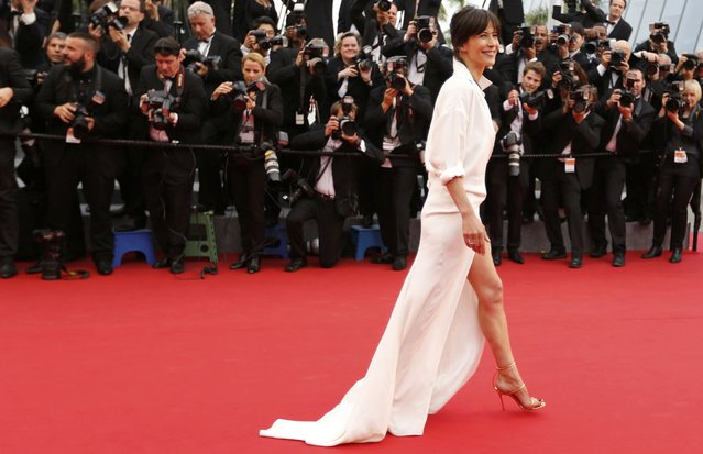 "Jury member actress Sophie Marceau poses on the red carpet as she arrives for the screening of the film ""Mad Max: Fury Road"" out of competition at the 68th Cannes Film Festival in Cannes, southern France, May 14, 2015. (Photo by Regis Duvignau/Reuters)"