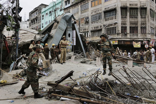 Security officers work on the area of a collapsed overpass in Kolkata, India, Friday, April 1, 2016. (Photo by Bikas Das/AP Photo)