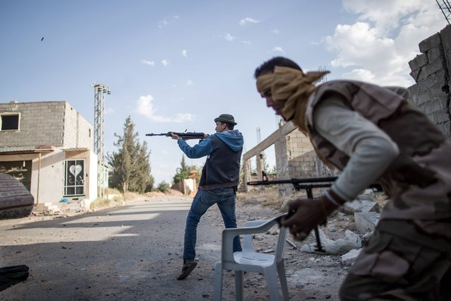 Fighters from forces of the UN-backed Libyan government fire at Libyan National Army (LNA) troops at the Al-Yarmook frontline in Tripoli, Libya, on May 13, 2019. According to the World Health Organization, more than 400 people were killed and at least 2,000 wounded since early April, with 11 additional ambulances have been impacted or suffered collateral damage. (Photo by AmruxSalahuddien/Xinhua News Agency)