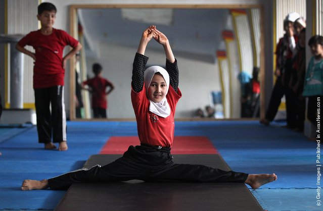 Afghan girls practice during gymnastics class at a U.S. funded gymnasium for women