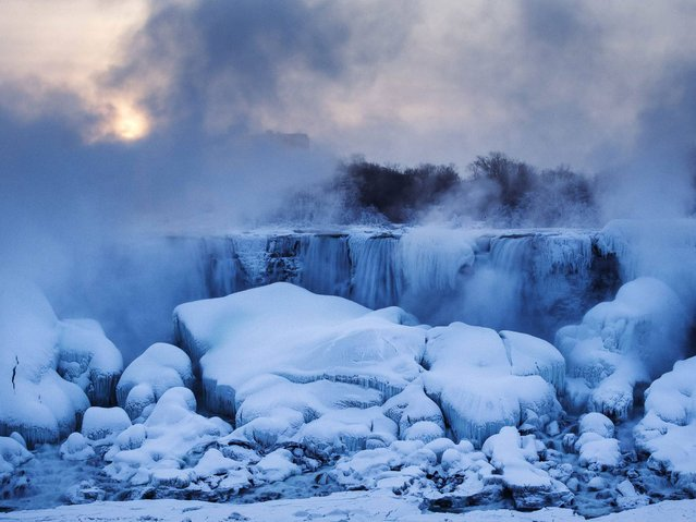 Icy mist rises over the Horseshoe Falls section of Niagara Falls during freezing temperatures. (Photo by Mark Blinch/Reuters)