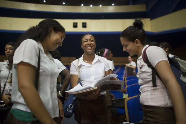 Daiana Terrero, 19, (C), laughs with friends at a break during a rehearsal with the Minnesota Orchestra in Havana, May 15, 2015. (Photo by Alexandre Meneghini/Reuters)