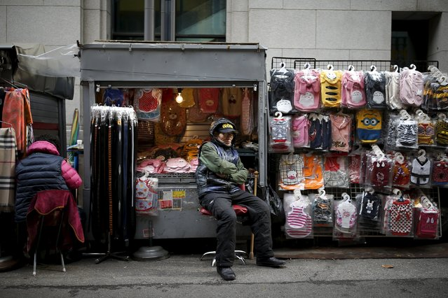 A shopkeeper naps at the Namdaemun Market in Seoul, South Korea, November 24, 2015. (Photo by Kim Hong-Ji/Reuters)