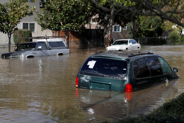 Vehicles are seen partially submerged in flood water after heavy rains overflowed nearby Coyote Creek in San Jose, California, U.S., February 21, 2017. (Photo by Stephen Lam/Reuters)