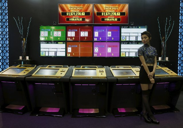 An attendant stands in front of a booth at the Global Gaming Expo (G2E) Asia in Macau, China May 19, 2015. (Photo by Bobby Yip/Reuters)