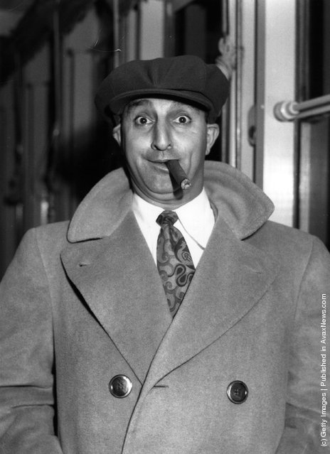 1950: US actor, comedian and producer Danny Thomas smoking a cigar